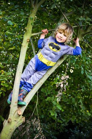 George climbing tree
